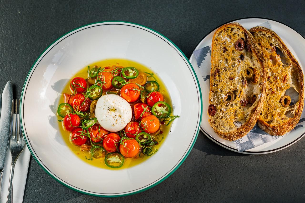 Burrata, confit tomato, candied olives, green chilli